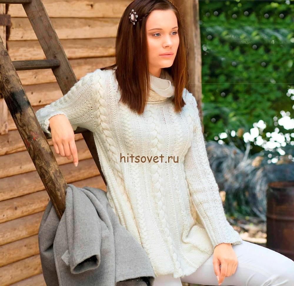 Белый пуловер с косами спицами